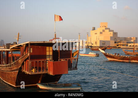 Fishing dhow in front of the Museum of Islamic Art, architect I.M.Pei, Doha, Qatar - Stock Photo