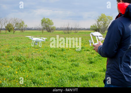 A man with a remote control in his hands. Flight control of the drone. Phantom - Stock Photo