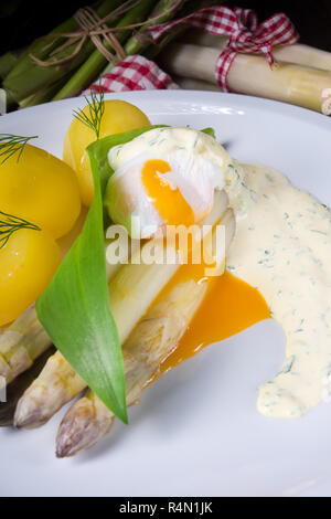 asparagus with wild garlic and poshed egg - Stock Photo