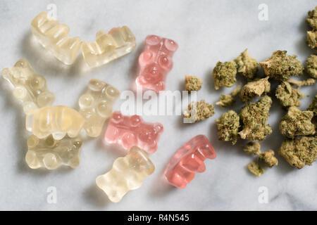 Marijuana and gummy bear edibles - Stock Photo