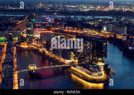Aerial view of Dusseldorf at night in Germany - Stock Photo