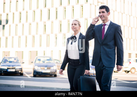 Business people in front of office building - Stock Photo