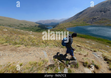 Woman hiking on Silver Dollar Trail in Colorado - Stock Photo