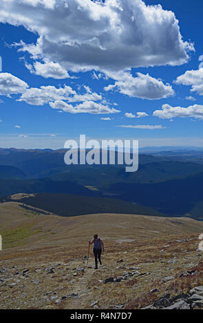 Woman hiking on Square Top Mountain in Colorado - Stock Photo