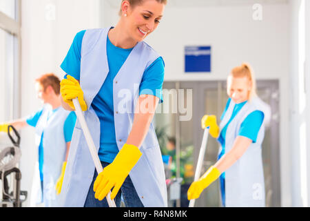 Commercial cleaning brigade working - Stock Photo