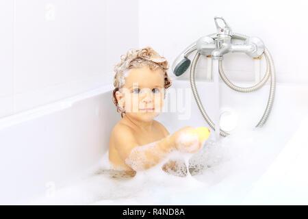 Little Boy Bathing Holding Soap On Head Stock Photo