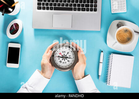 Person Hand With Compass On Office Desk - Stock Photo