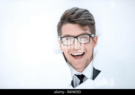 happy businessman breaks through the paper. - Stock Photo