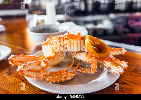 Boiled crab on a plate in a cafe, America. With selective focus - Stock Photo