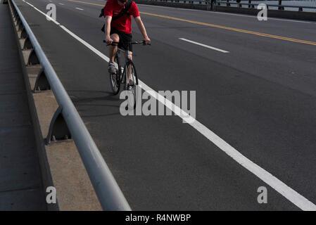 Low section shot of cyclist riding along bridge on Charles River, Boston, Massachusetts, USA - Stock Photo