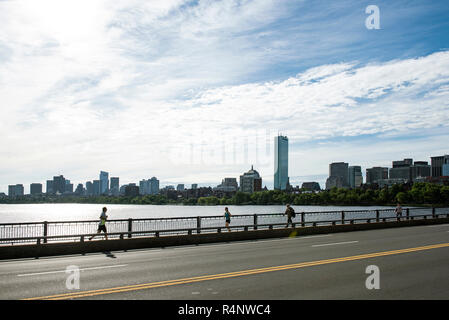Side view of people running and walking on bridge on Charles River, Boston, Massachusetts, USA