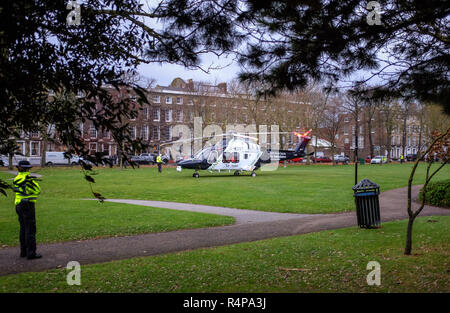 Worthing, Sussex, UK. 28th November 2018 - The Kent Surrey & Sussex Air Ambulance takes off from Steyne Gardens in Worthing after responding to a report of a man having fallen from a car park in Worthing . Police were alerted at the Guildbourne Centre car park by South East Coast Ambulance about 2.08pm on Wednesday (28 November). Credit: Simon Dack/Alamy Live News - Stock Photo