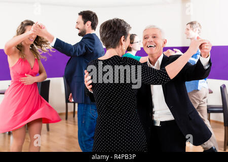 Group of people dancing in dance class - Stock Photo