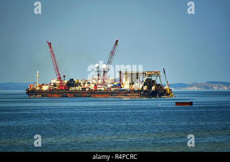 installation of Nordstream 2 gas pipe in Germany to Western Europe in Lubmin by ship in baltic sea in 2018 - Stock Photo
