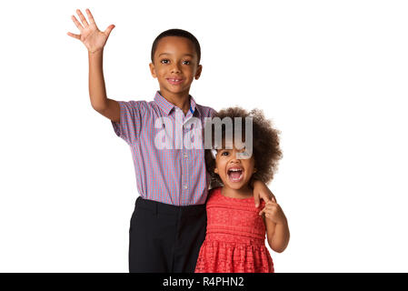 Two excited and cheerful siblings brother and sister, isolated on white background - Stock Photo