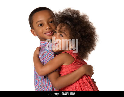 Two cheerful african-american siblings brother and sister hugging each other, isolated on white background - Stock Photo