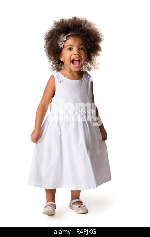 Full-length portrait of cute cheerful african american little girl, isolated over white background - Stock Photo