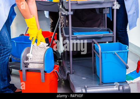 Cleaning ladies mopping floor - Stock Photo