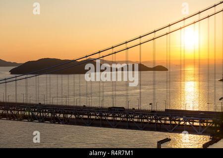 Japanese Great Seto Bridge at sunset - Stock Photo