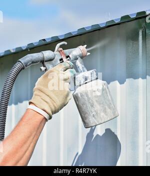 Spraying white color - Stock Photo
