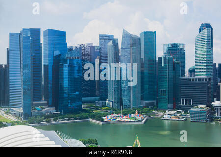 Beautiful super wide-angle summer aerial view of Singapore, with skyline, bay and scenery beyond the city, seen from the observation deck - Stock Photo