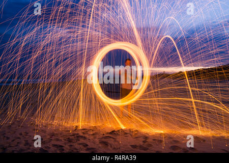 Steel wool spinning to make an attractive pattern - Stock Photo