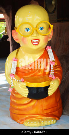 neophyte novice monk doll with arm monk bowl / cute of statue model of neophyte in the temple thailand - Stock Photo