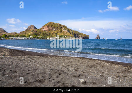 Black volcanic beach on the Vulcano Island, Aeolian Islands, Italy - Stock Photo