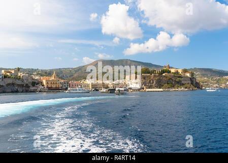 Castle rock and Marina Corta in Lipari seen from the sea, Aeolian Islands, Italy - Stock Photo