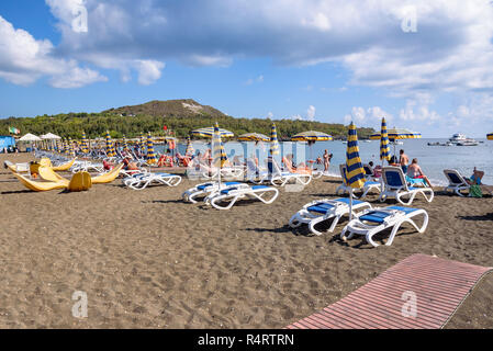Vulcano Island, Italy - September 9, 2016: People sunbathe on the beach on Vulcano Island, one of the volcaninc islands of Aeolian archipelago - Stock Photo