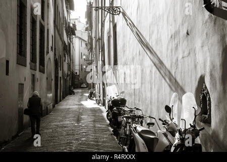 Street scene, late afternoon sunlight,Florence, Italy. - Stock Photo