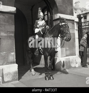 1960s, historical, a mounted member of the Household Cavalry, the Queen's Life Guard, standing outside Horse Guards, the official entrance to St James and Buckingham Palace since 1660. - Stock Photo