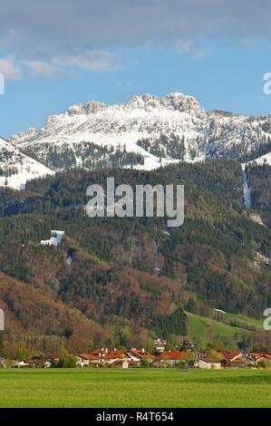 view of aschau and the kampenwand in the snow,priental,chiemgau,upper bavaria,southern germany - Stock Photo