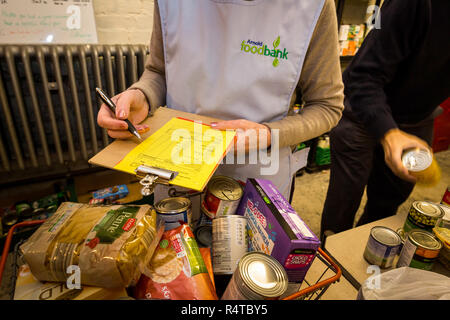Volunteers sort out newly arrived donations at Arnold Foodbank Daybrook Baptist Church's food store and provide those in need with donated food in Nottingham. - Stock Photo