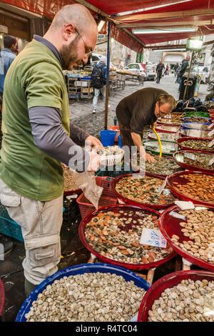 Fishmonger stall at Via Sopramuro, Mercato di Porta Nolana quarter, Naples, Campania, Italy - Stock Photo
