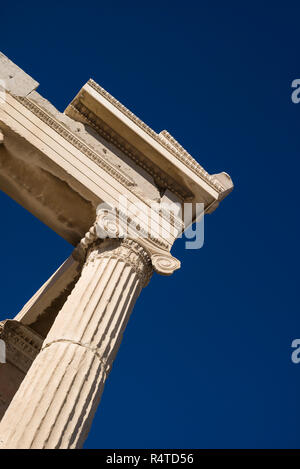 Athens. Greece. Detail of Ionic column (shaft) and capital of the Erechtheion (Erechtheum) ancient Greek temple on the Acropolis. - Stock Photo
