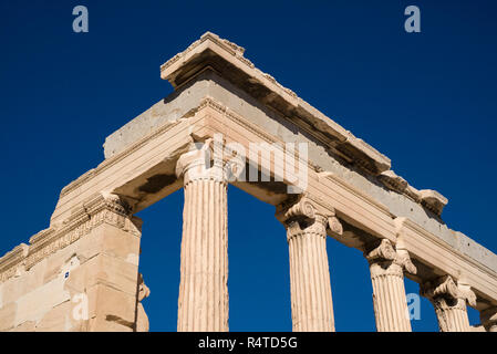 Athens. Greece. Detail of Ionic columns (shaft) and capital of the Erechtheion (Erechtheum) ancient Greek temple on the Acropolis. - Stock Photo