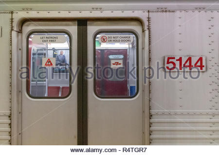 Toronto, Canada-November 27, 2018: Doors of a vintage Bombardier train used in the subway system (TTC). Train number 5144. - Stock Photo