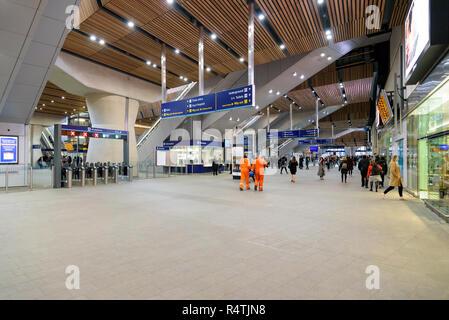 London, UK - April 26, 2018: Passengers at the London Bridge train station hall - Stock Photo