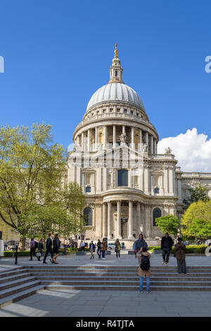 London, UK - 26 April, 2018: Tourists take pictures in front of St Pauls Cathedral - Stock Photo