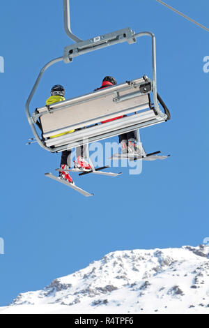 skier in the chairlift - Stock Photo
