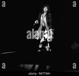 FRANKFURT, GERMANY: Mick Jagger from The Rolling Stones perform live on stage at the Festhalle in Frankfurt, Germany on April 28 1976 as part of their European tour (Photo by Gijsbert Hanekroot) *** Local Caption *** Rolling Stones, Mick Jagger - Stock Photo