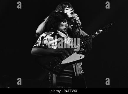 FRANKFURT, GERMANY: Mick Jagger, Ron Wood from The Rolling Stones perform live on stage at the Festhalle in Frankfurt, Germany on April 28 1976 as part of their European tour (Photo by Gijsbert Hanekroot) *** Local Caption *** Rolling Stones, Mick Jagger, Ron Wood - Stock Photo