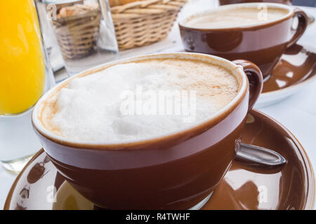 Richly covered breakfast table. - Stock Photo