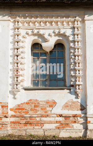 Veliky Novgorod, Russia. Windows decorated with arches and stucco at the facade of Resurrection Cathedral of Derevyanitsky monastery in Veliky Novgoro - Stock Photo