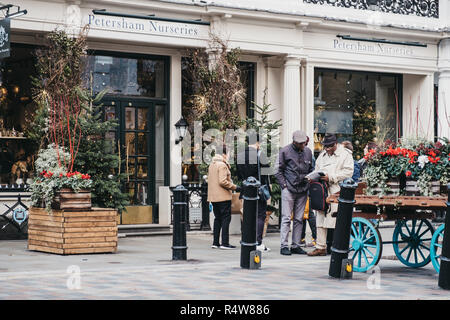 London, UK - November 21, 2018: People walking past Petersham Nurseries in Covent Garden, London, UK. Covent Garden is a famous tourist area in London - Stock Photo