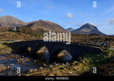The old stone bridge over the Sligachan River with a backdrop of the Cuillin Hills, Isle of Skye, Highland Region, Scotland, UK - Stock Photo