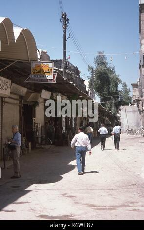 View of the entrance to the Umayyad Palace Restaurant, located on an alleyway along the south wall of the Umayyad Mosque, in the old city of Damascus, Syria, June 1994. () - Stock Photo