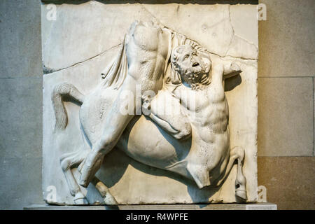 Part of the Elgin Marbles in the British Museum, London, UK. Lapith and Centaur fighting, South Metope II - Stock Photo