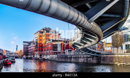 The steel serpent like Valentine Bridge. A pedestrian and cycle way over the floating harbour from Glass Wharf to Bristol Temple Mead's rail station. - Stock Photo